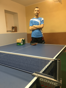 Petroj Sorin before training near table tennis table
