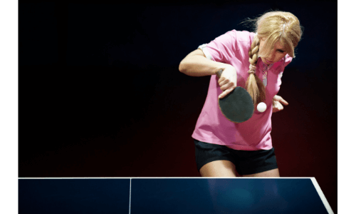 Benefits of playing table tennis girl reacting to the ball