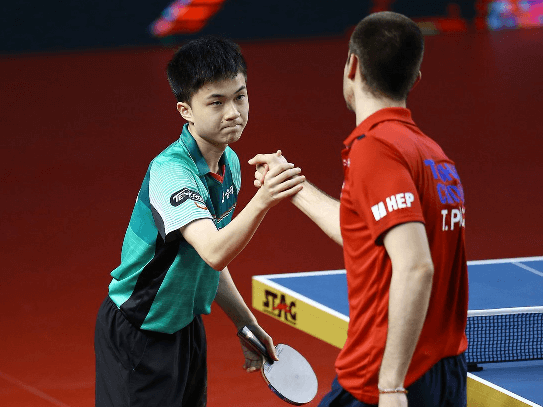 Shaking hands of two table tennis players as a fairplay table tennis game