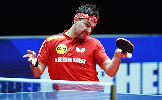 Timo Boll making a topspin table tennis