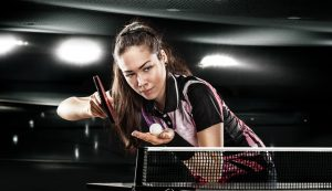 Table tennis skills for beginners woman serves on the table