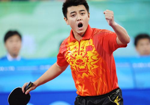 Wang Hao celebrating winning point table tennis