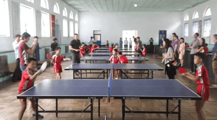 kids in north korea playing ping pong training
