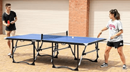 Vermont Foldaway Outdoor family playing ping pong outside