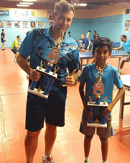 from tournament in los angeles a man with a kid in sports hall