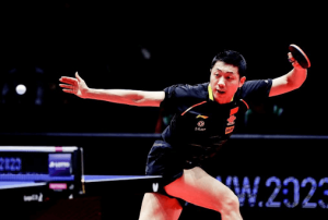 xu xin playing table tennis at a distance from the table