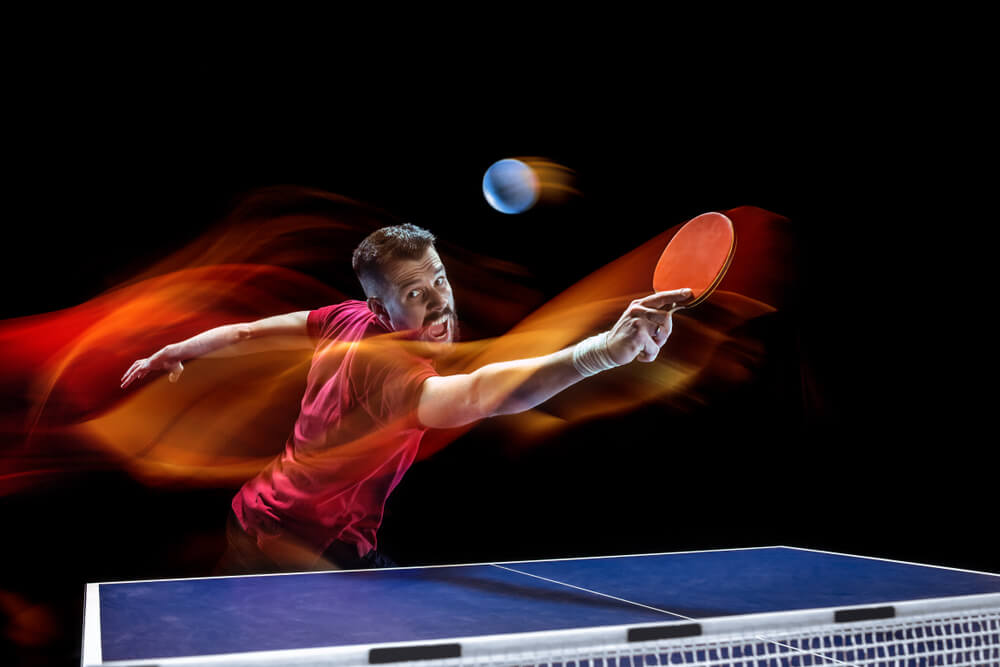 7 best tips to improve table tennis fast image player in motion playing backhand