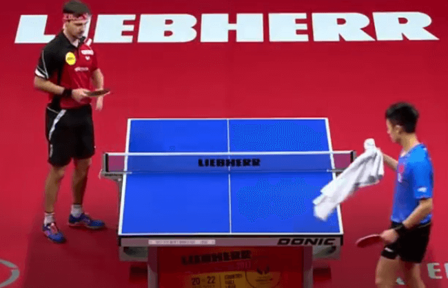 lin and timo boll using towel between points table tennis
