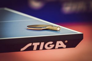 stiga table tennis table with racket on it